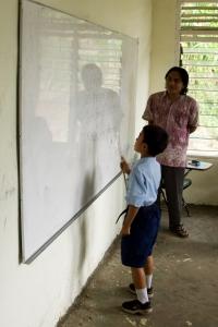 Balinese boy learning to read, Pengulusan school